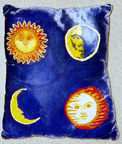 hand painted pillow with sun and moons