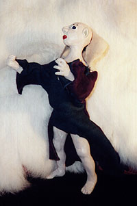 Sculpey elfin figure with leather shirt.